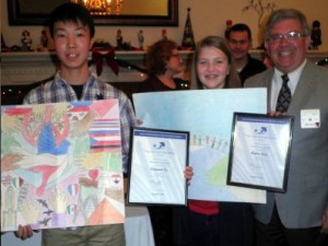 Peace Poster winners Seungmin Lee (Rocky Run Middle School) and Hailey Steen (Stone Middle School) display their winning Peace Posters and certificates with Lion Jeff Root, FHLC Peace Poster Chairperson.