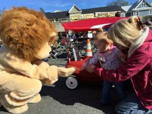Lion mascot meets children