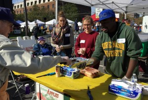 GMU students (Alpha Phi Omega service fraternity) help Lions sell food